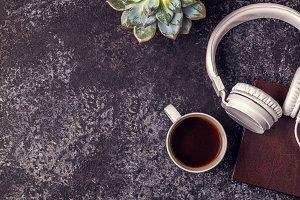 notepad, headphones and coffee