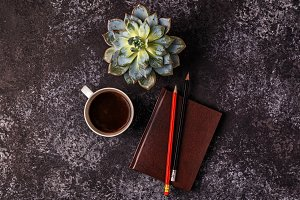 notepad, flower and coffee