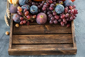 Autumn fruits in wooden box, harvest