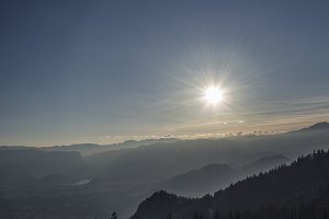 Strong Sun over Forest and Valleys