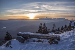 Sunset behind resting place Bench