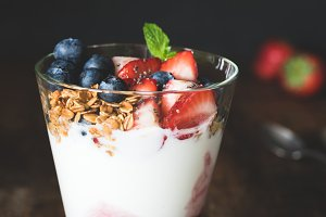 Yogurt with granola, strawberries and blueberries