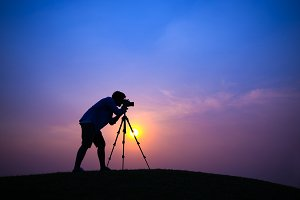 Photographer on silhouette