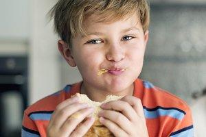 Caucasian boy eating