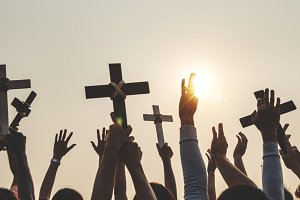 Christians holding up crosses