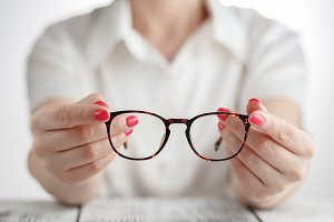 Female with brown framed glasses