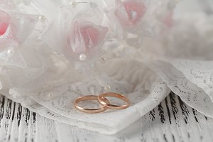 Wedding rings on white satin