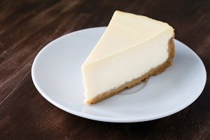 Plain cheesecake slice on white plate