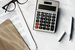 Close up of calculator and notes