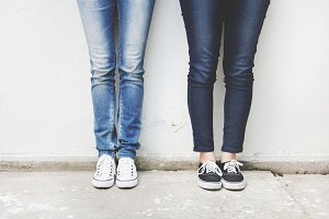 Closeup of pairs of legs in jeans