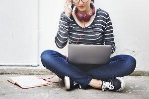 Young woman is using digital device