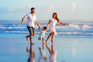Happy family have a fun on beach