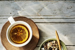 Cup of lemon tea and cereal
