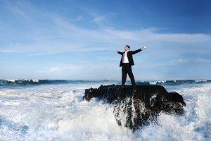 Businessman in a stormy ocean