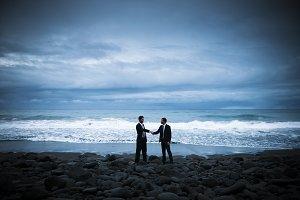 Business handshake at the beach