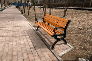 Red bench in the park outdoors