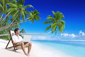 Man work on laptop at beach