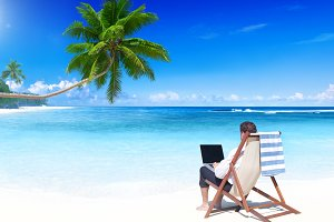 Businessman work on laptop at beach