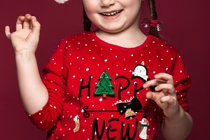Funny little girl in the New Year's image, showing different emotions.