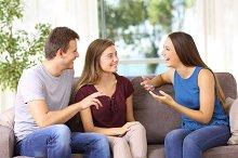 Three joyful friends talking