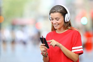 Teen in red listening to music
