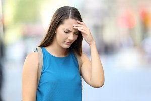 Single woman suffering headache