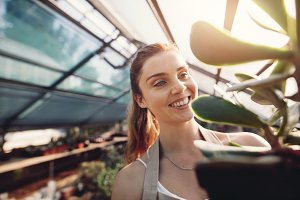 Female worker in greenhouse