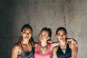 Sportswomen standing together