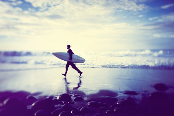 Businessman with a surf board