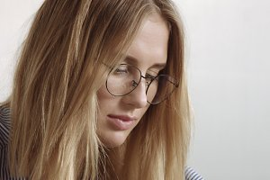 Beautiful young professional blond in glasseswoman portrait office style