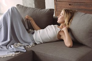 Young blond woman relaxing on the couch