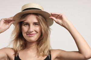 Pretty blond girl in straw hat