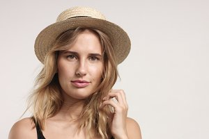 Pretty blond girl in straw hat