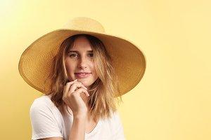 Smiling blonde woman wearing hat