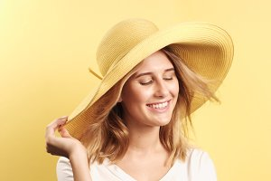 Smiling blonde woman wearing hat
