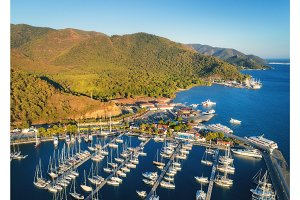 Aerial view of boats and beautiful mountains at sunset