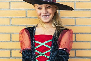 Beautiful girl disguised of witch.
