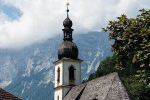 Scenic view of tower of church against mountains