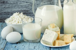 Different dairy products on the wooden background