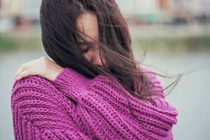 Violet knit cardigan on the girl with long hair
