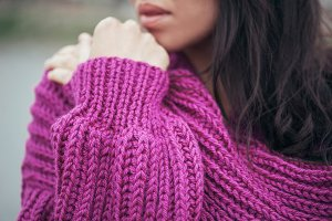 Violet knit cardigan on the girl with long hair, details.