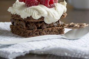 Chocolate cake with cream and raspbe