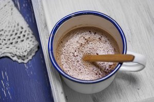 Hot chocolate in white metal cup on