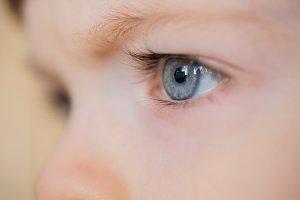 Closeup of eyes of a blue-eyed child with long eyelashes