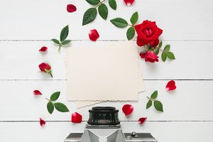 Photo frame, camera and roses