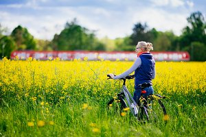 Girl with bike in meadow