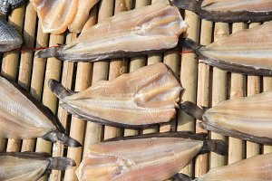 dried fish on bamboo table