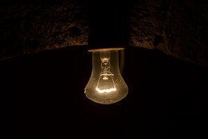 Old dusty light bulb in the dark