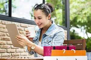 Woman chill at cafe after shopping