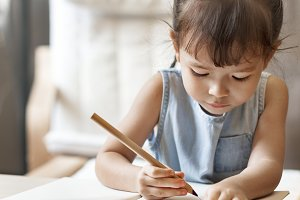 Young girl finishing her homework